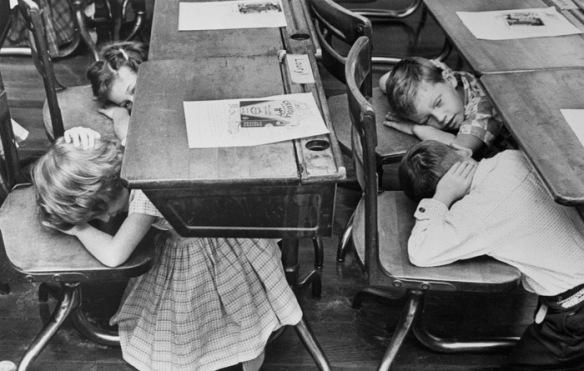 Children Ducking Under Desks